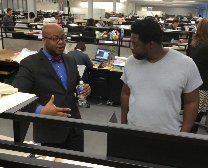 Charles Davis speaking with student at Morgan State